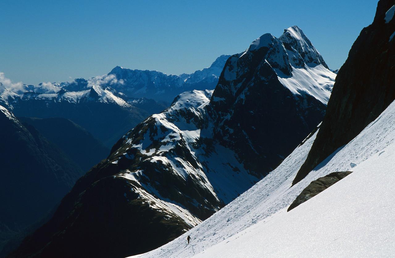 Traversing under Mount Hart. Mount Elliot above