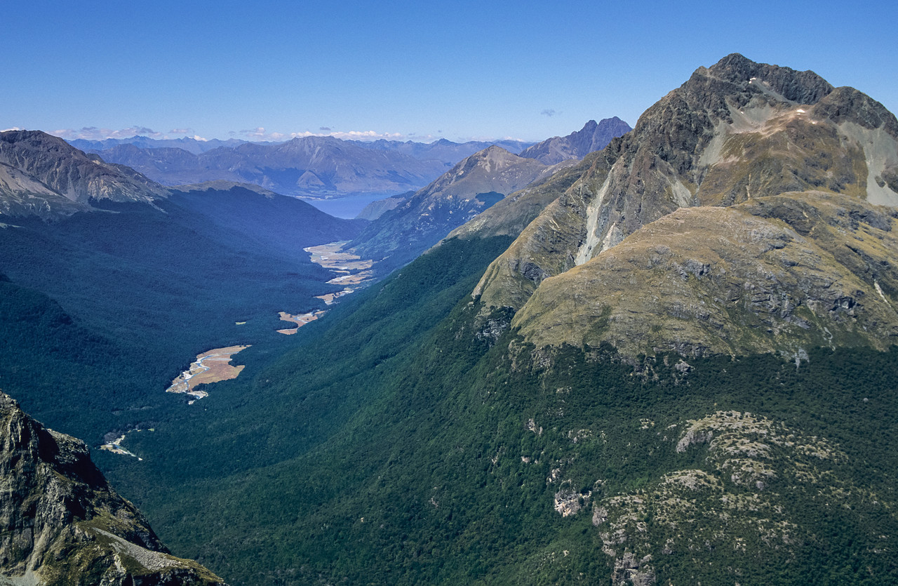 View down the Caples River to Lake Wakatipu from Unnamed Peak 1695m, Ailsa Mountains. Pt 2024m is on the far right; Tooth Peak just behind and left of it