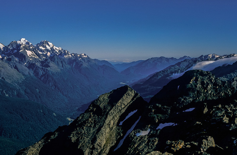 View down the Hollyford River from Unnamed Peak 1777m. Mount Tutoko and Mount Madeline on the far left