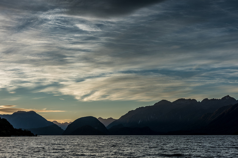 Lake Manapouri in the evening light. Cone Peak, the Beehive and the Cathedral Peaks are on the skyline
