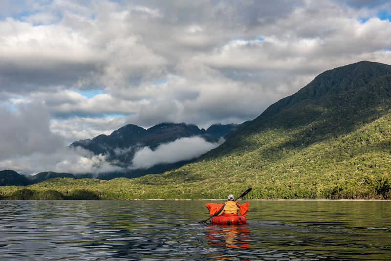 Paddling Lake Manapouri. The Cathedral Peaks are in the background.