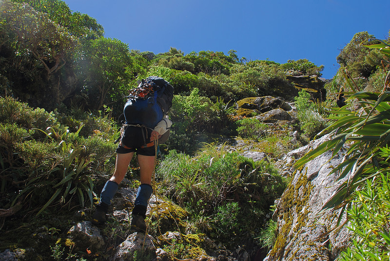 Abseiling onto the 'terrace' leading into the upper basin of Sinbad Gully