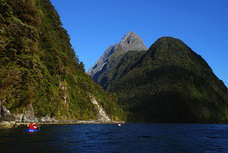 Paddling across Milford Sound - approaching Sinbad Gully. Mitre Peak above