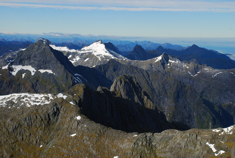 View south from the Llawrenny High Peak. Mount Danger is on the far left, exactly in front of the Lady of the Snows. The snowy mountain to the left of centre image is Unnamed Peak pt 1811m