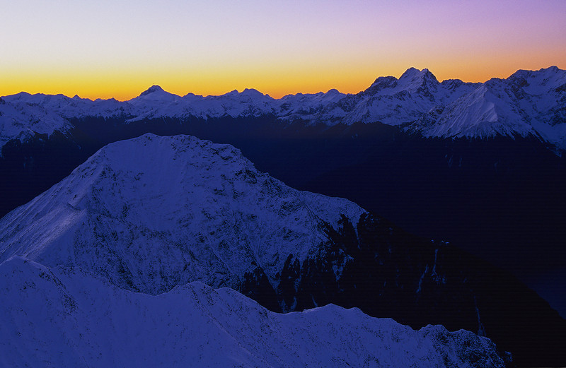 The Murchison Mountains at dusk. Mount Irene is on the left, right behind (and above) Forward Peak. Mt Lyall and Mt Owen to the right