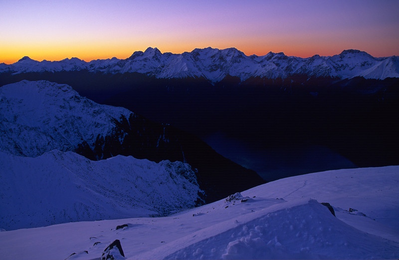 The Murchison Mountains at dusk. Peaks on the horizon are (from left to right) Mount Irene, Mount Lyall, Mount Owen, Black Cone