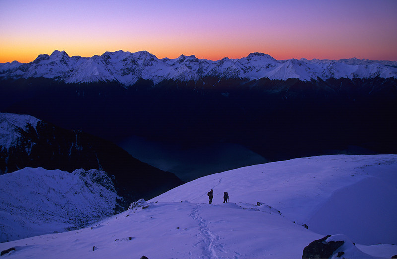 At dusk on Mt Luxmore. Peaks on the horizon are, from left to right, Mt Lyall, Mt Owen, Black Cone