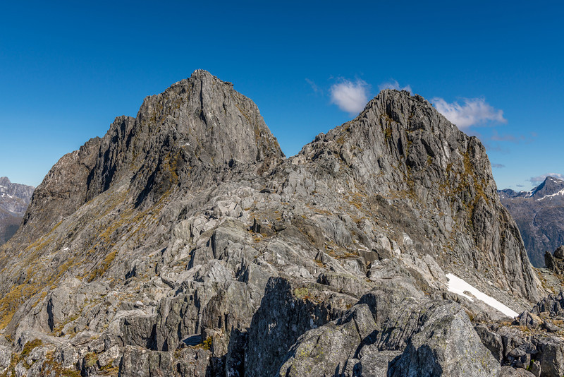 """The Watchtower"" (Pt 1674m, left) and Unnamed Peak Pt 1570m (right) on the ridge dividing MacKay Creek and Poseidon Creek. Mount Elliot is just visible on the far right. We completed a likely first ascent of The Watchtower."