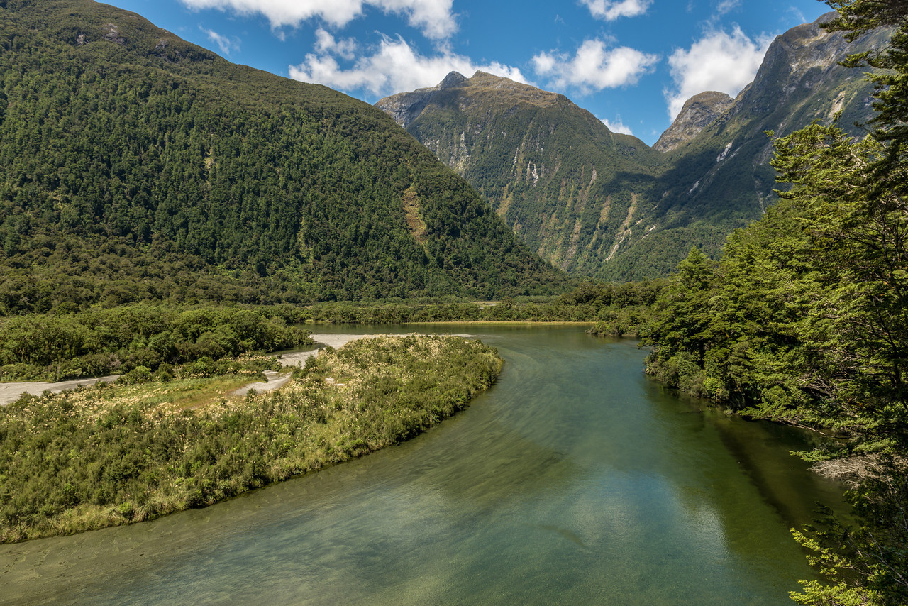 View from the track through the bluffs at the southern end of Lake Ada, Milford Track. The Joes River comes in at centre image