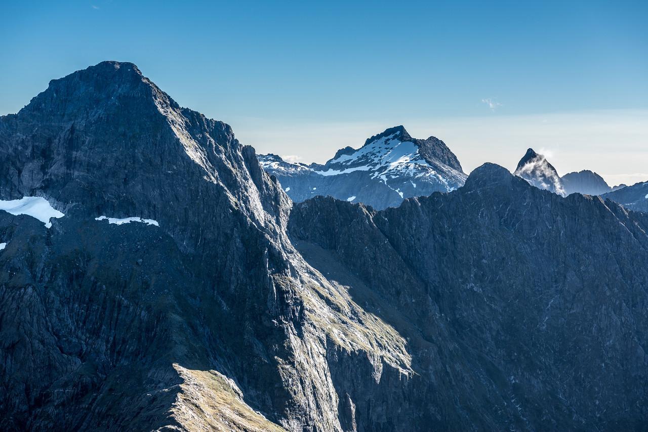 "Mount Danger, Unnamed Peak Pt 1811m, ""Safe Mountain"" (Pt 1634m) and Unnamed Peak Pt 1714m from Pt 1632m above Lake Liz."
