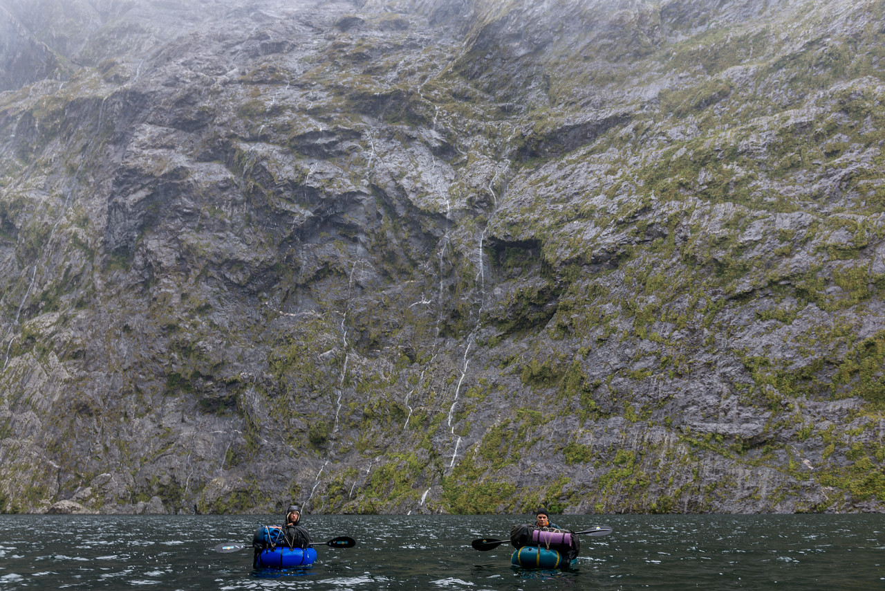 Pack rafting across the MacKay Lake. Sheer cliffs on both sides of the lake mean there is no practical route around it.