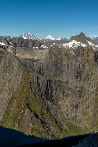 View across Poseidon Creek from Pt 1632m: Terror Falls (the highest waterfall in New Zealand), Lake Terror and Terror Peak. Mount Tutoko and Mount Madeline stand out in the background