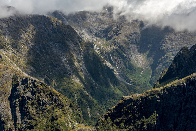 """View from """"The Watchtower"""" (Pt 1674m), over """"Disgusting Saddle"""" and into the head of the Transit River. The waterfall draining Lake Moreton (""""Matawai Falls"""") is just right of centre image"""