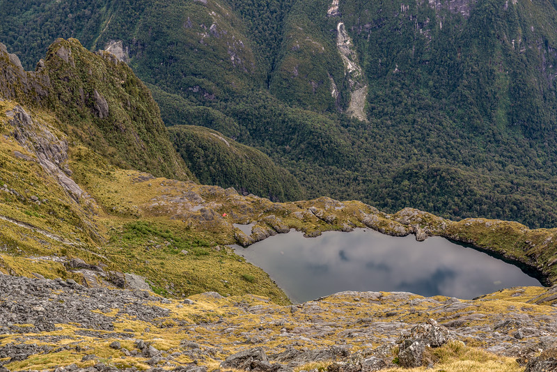 View down onto Lake Liz and Kakapo Castle (top left). The Transit River below