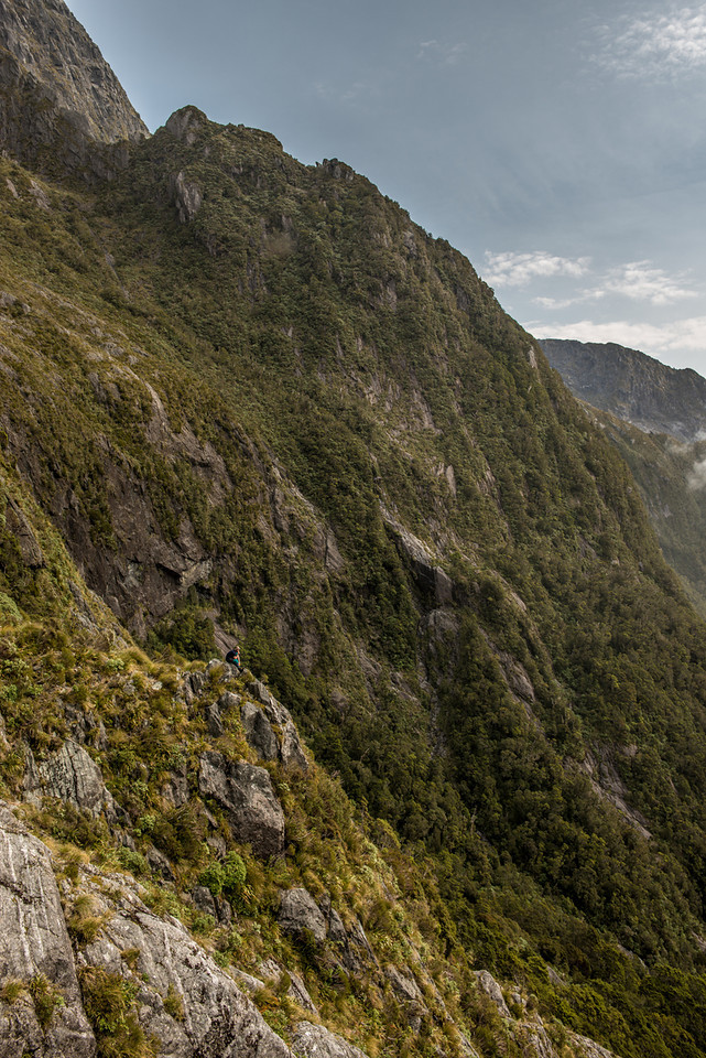 Max contemplates the steep descent from Lake Liz into the Transit River. Kakapo Castle is right above