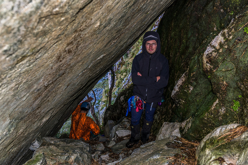 A tunnel leading onto a broad ledge marks the end of the first pitch on our route out of the MacKay Creek headcirque