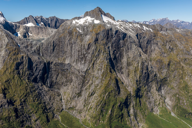 Lake Terror and Terror Peak at the head of Poseidon Creek. The waterfall draining Lake Terror, 750m high, is the highest waterfall in New Zealand. The unclimbed faces of Terror Peak are one of the biggest unclaimed mountaineering challenges in the country