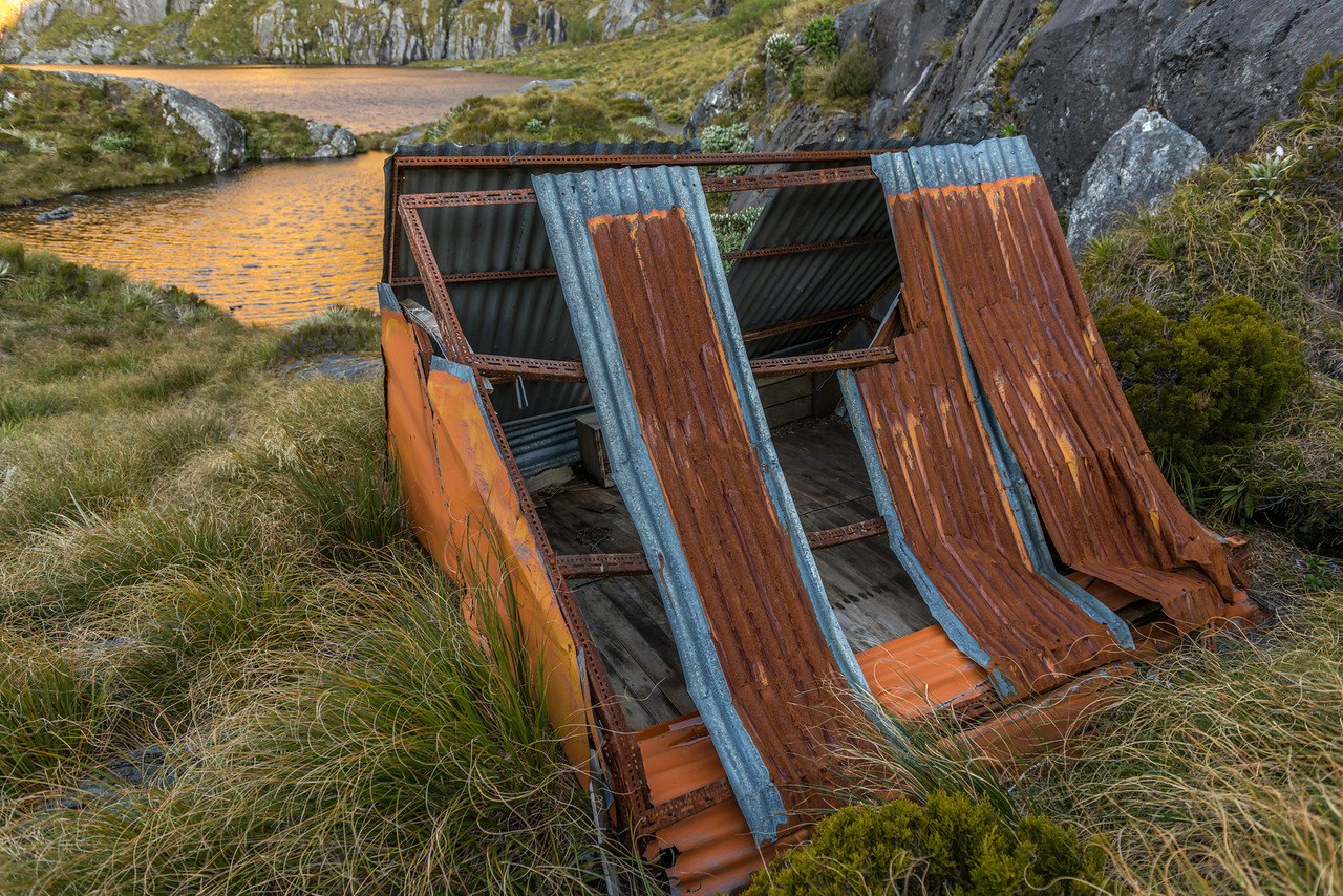 The old kakapo bivvy near the outlet of Lake Liz - in a derelict state unfortunately! We were able to repair it just enough for it to shelter us from the cold wind
