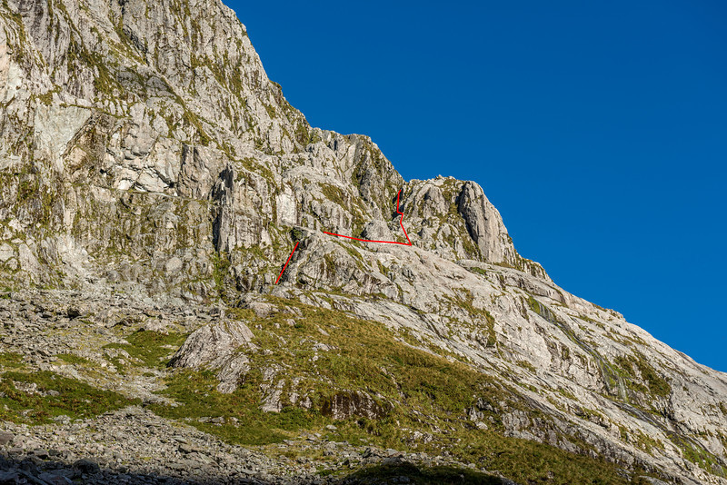 The red line shows the route we climbed the next day. Where the line is discontinued, we followed a tunnel out of a chimney and onto the ledge