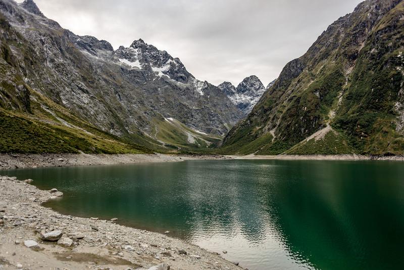 Lake Marian. Mt Crosscut, Marian Peak, Sabre Peak and Adelaide Peak in the back