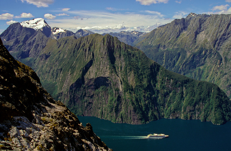 View across Milford Sound from the south-east ridge of Mitre Peak. Mt Pembroke is on the left and the Lion at centre image. To the right, the summit of Mt Grave is just visible over the ridge of Benton Peak and Mills Peak.
