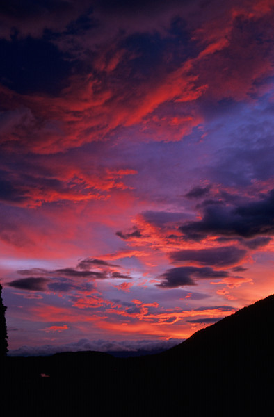 Sunset on the Milford Road. The colour is enhanced by the large bush-fires in Australia.