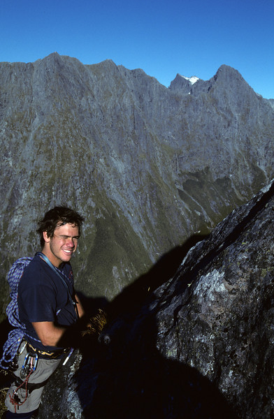 David on the south-east ridge of Mitre Peak. The Llawrenny Peaks behind