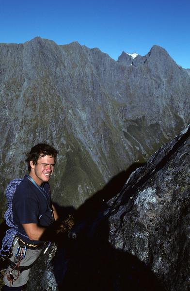 David on the south-east ridge of Mitre Peak. The Llawrenny Peaks behind