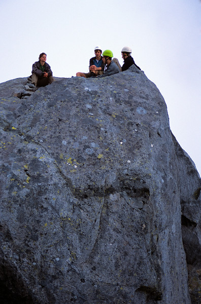 The team at the edge of a 1000m precipice - right on the summit of Mt Isolation
