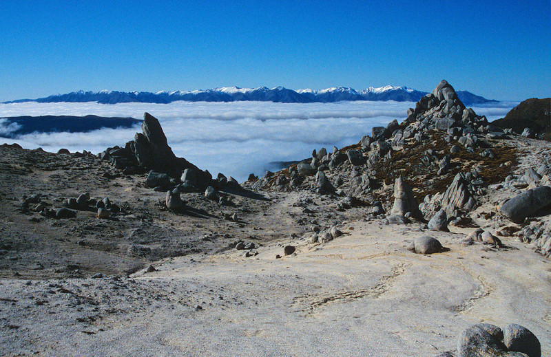 Rock formations on Mt Titiroa's north ridge. The Takitimu Mountains in the background