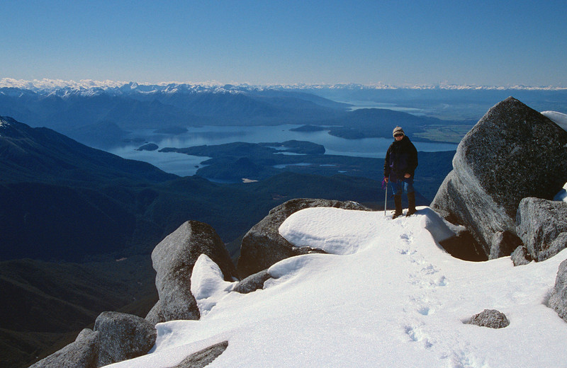 On the summit of Mt Titiroa. Lake Manapouri in the background