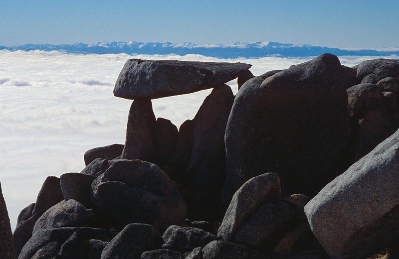 Granite boulders on Mt Titiroa's north ridge. The Takitimu Mountains in the background