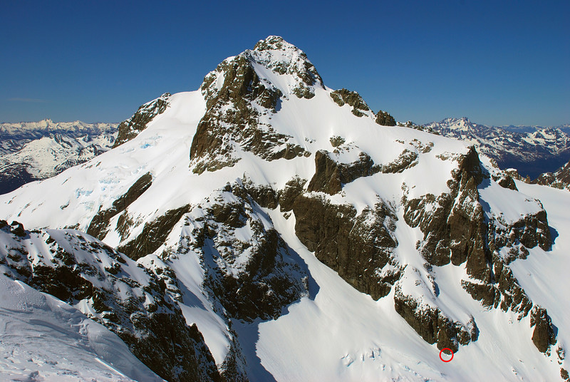 Mount Madeline from the upper slopes of Mount Tutoko. Our campsite is highlighted by a red circle