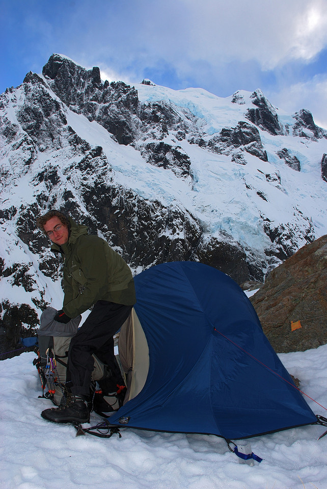 Campsite at the 'Rock of Discomfort', 200m below Turners Biv. The south face of Mount Tutoko above