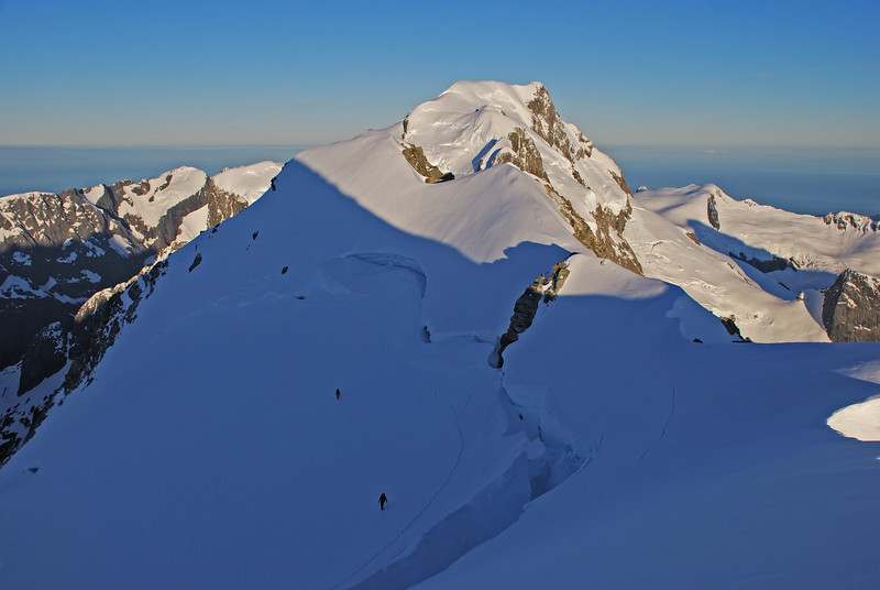 Approaching the summit of Mt Madeline. Mt Tutoko behind