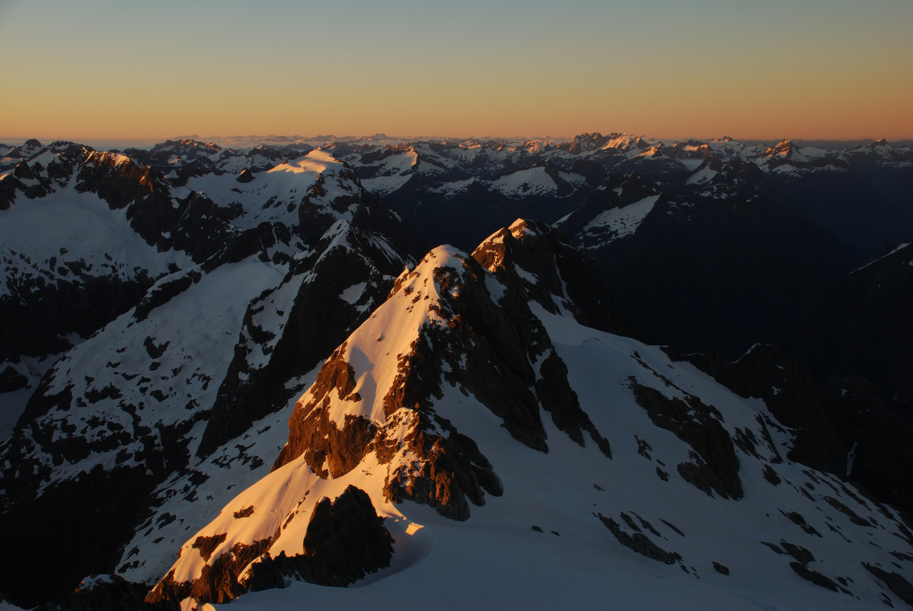 First sunlight from the slopes of Mt Madeline. Mt Syme is in the foreground; Mt Underwood is the sun-lit snowy peak to the left