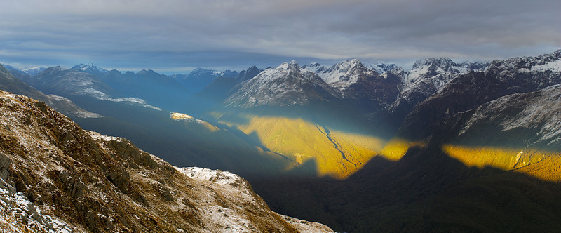 The shade of the Ailsa Mountains projected onto the slopes of the Darran Mountains, across the Hollyford River