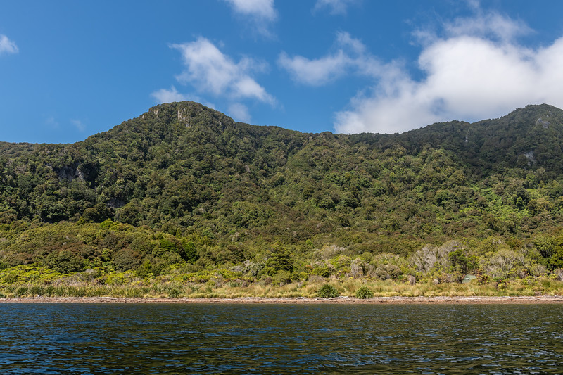 Te Oneroa A-Frame Hut from the sea. Preservation Inlet, Fiordland National Park.