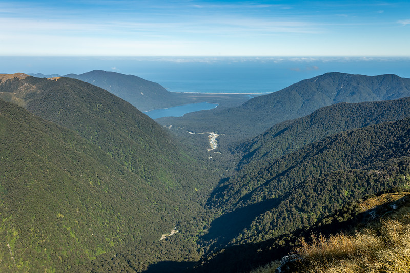View down Hokuri Creek to Lake McKerrow and Martins Bay from Pt 1401m. May Hills on left, Sara Hills on right. Skippers Range, Fiordland National Park.