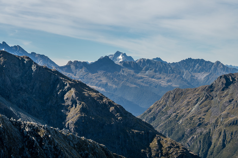 View from Pt 1401m, Skippers Range. From left to right are Poseidon Peak, Welshman Peak, Barrington Peak, Somnus, Momus and the Bryneira Range High Point (Pt 1793m). Fiordland National Park.