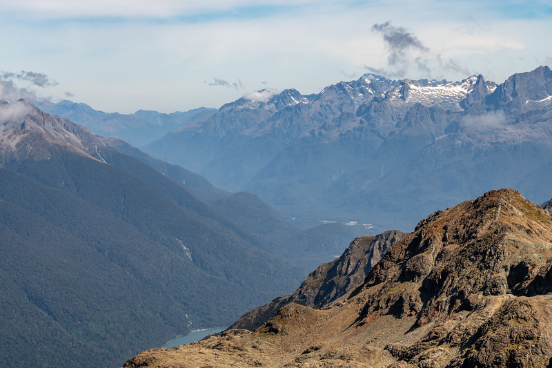 View up the Hollyford River from Skippers Range High Point. The Darran Mountains are in the background. Fiordland National Park.