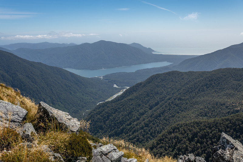 View down Hokuri Creek to Lake McKerrow and Martins Bay. Skippers Range, Fiordland National Park.