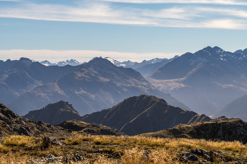 View east from Pt 1401m, Skippers Range. The Little Red Hill Range is on the left; Elespie on the right. The Northern Olivines are on the skyline in the background. Fiordland National Park.