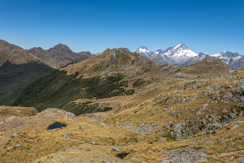 Climbing towards Pt 1507m. Skippers Range, Fiordland National Park.