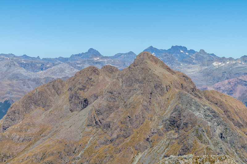 Pt 1620m from Pt 1507m, Skippers Range. Sir William Peak, O'Leary Peak, Mount Earnslaw and Cosmos Peaks are on the skyline in the background. Fiordland National Park.