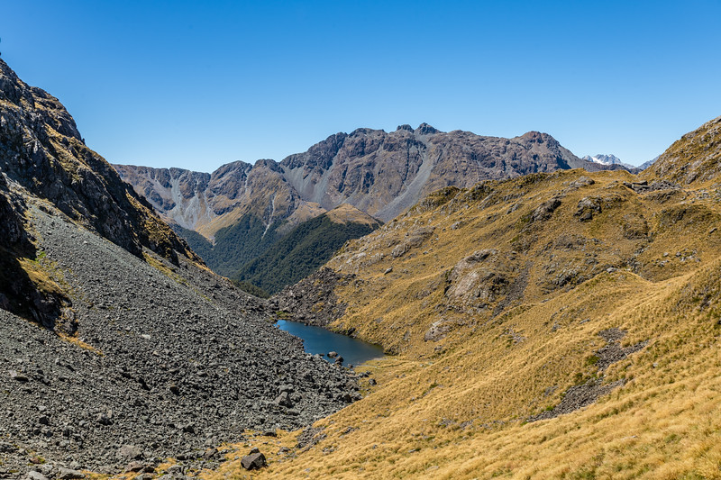 Tarn south-east of Pt 1507m. Skippers Range High Point in the background. Fiordland National Park.