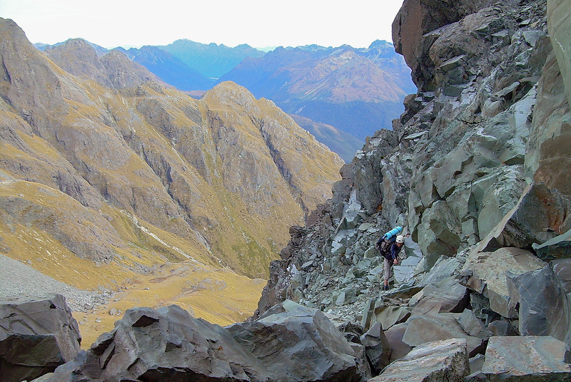 Scrambling to the summit of unnamed peak 1821m. The snowgrass couloir in the background was our route from Sunny Creek into Roaring Creek in the morning. Photo Kat Manno
