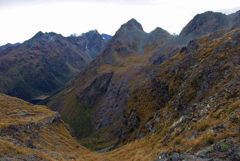 View into Roaring Creek and Lake MacKenzie from the pass out of Sunny Creek. Our route continued over the summit of unnamed peak 1821m at centre image. Ocean Peak, Somnus and F-Knob are on the horizon in the left half of the photograph