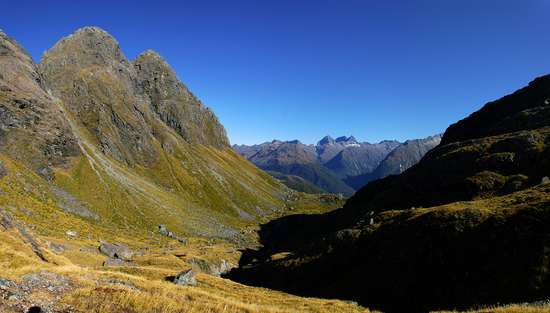 Looking down Sunny Creek from near our campsite. Peaks 1727m and 1667m are on the left, while the Earl Mountains are in the background
