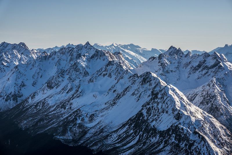 View from Pt 2024m: Unnamed Peak Pt 2117m (Humboldt Mountains) and Upper Peak. The Olivine Range is in the background